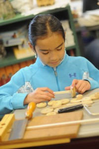 Girl putting together wood pieces